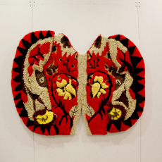 Anna Perach<br />The red house lord<br />2018<br />tufted yarn and artificial hair<br />115x140cm