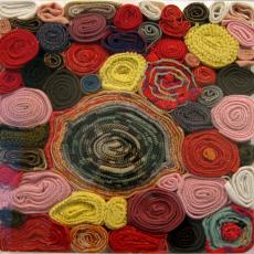 Małgorzata Markiewicz<br />Untitled<br />2009<br />blankets, plexiglass<br />50x50x12.5cm