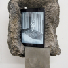 Evy Jokhova, Totem III, 2017. Cast cement, plaster acrylic, polymer, stone effect on polystyrene, steel, wifi tablet.