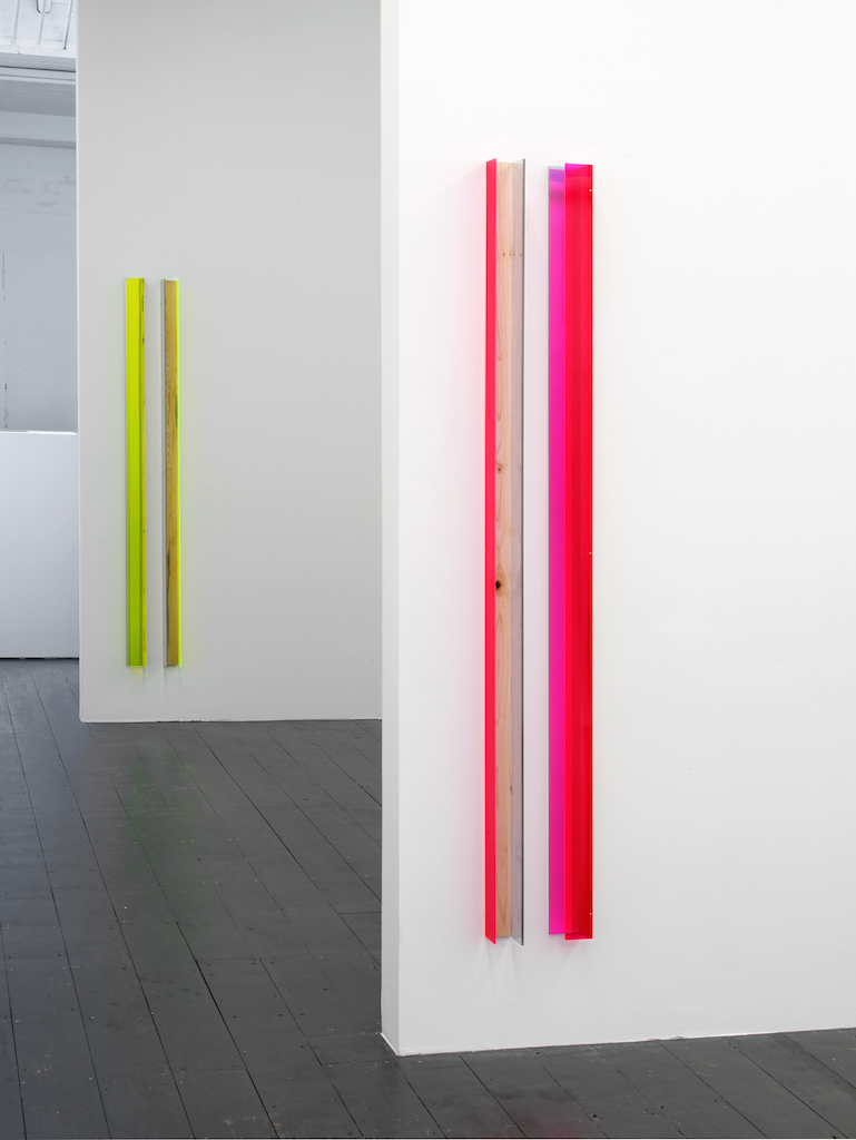 Jyll Bradley, G/raft 1&2, each two part sculpture of pink fluorescent edge-lit Plexiglas, two-way mirrored Plexiglas and vintage sawn hop hole, each part: 168 x 7.5 x 6 cm (Height of the work is the height of the artist), Edition of 3