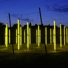 Jyll Bradley, Green/Light (For M.R.), 2014. Light sculpture  Timber poles, wire-work grid, aluminium poles with LED inset, plexiglass, mirrored acryclic, coir string, aggregate, steel anchorage, 22m x 22m