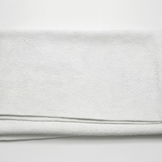 Joanna Rajkowska<br />Blanket Infected with Smallpox (from the series Painkillers II)<br />2015<br />Powdered analgesic, polyurethane resin, life-size cast<br />74 x 50 x 7 cm