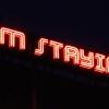 Shaun C Badham, Installation view of I'M STAYING, 2014, Neon, 5.5 x 0.8m