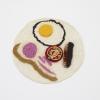 Su Richardson, Burnt Breakfast, 1975-1977, knife, fork and wool, 20 cm diameter.