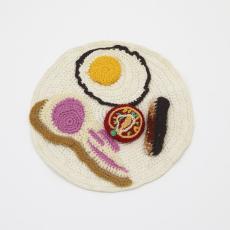 Su Richardson<br />Burnt Breakfast, 1975-1977<br />knife, fork and wool<br />20 cm diameter.