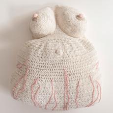 Su Richardson<br />Pregnant Cushion<br />2021<br />Crochet cotton, dishcloth cotton backing<br />52x44x18cm