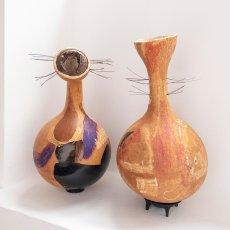Melania Toma<br />Uterus Pumpkin (1 and 2)<br />2020<br />pumpkin, wood varnish, oil pastel, pigments, oil panting, vegetable (carob family ) vegetables fibers<br />70x30cm approx. each